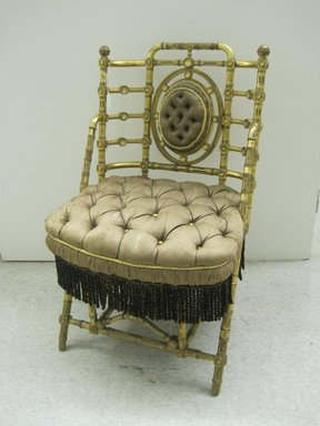 George Jacob Hunzinger (American, born Germany, 1835-1898). <em>Chair</em>, March 30,1869 (patented). Gilt wood, modern textile, 31 1/2 x 19 3/8 x 18 5/8 in. (80 x 49.3 x 47.2 cm). Brooklyn Museum, Gift of Mrs. J. Fuller Feder, by exchange and Designated Purchase Fund, 2012.36. Creative Commons-BY (Photo: Brooklyn Museum, CUR.2012.36_view2.jpg)