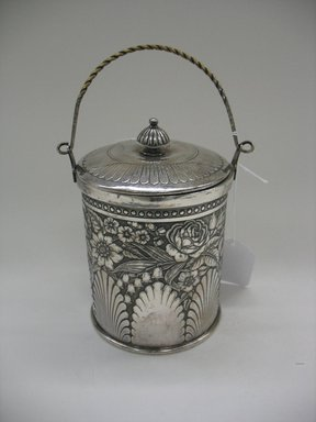 James W. Tufts (1875-ca. 1914). <em>Biscuit Jar with Lid</em>, 1875-1885. Silverplate, a, with handle: 9 3/4 x 5 1/4 x 4 9/16 in. (24.8 x 13.3 x 11.6 cm). Brooklyn Museum, Gift of Sarah Eigen, 2012.60.5a-b. Creative Commons-BY (Photo: Brooklyn Museum, CUR.2012.60.5a-b.jpg)