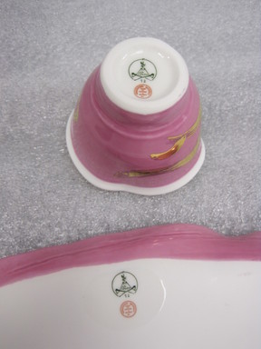 Betty Woodman (American, 1930-2018). <em>Study for Cup and Saucer</em>, 2012. Porcelain (pink), a. cup: 2 1/4 x 2 7/8 in. (5.7 x 7.3 cm). Brooklyn Museum, Gift of Charles Woodman, 2013.19.2a-b. © artist or artist's estate (Photo: Brooklyn Museum, CUR.2013.19.2a-b_marks.jpg)