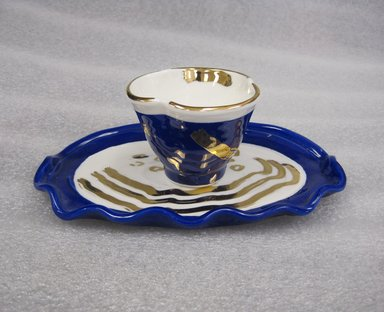 Betty Woodman (American, 1930-2018). <em>Study for Cup and Saucer</em>, 2012. Porcelain (blue), a. cup: 2 x 2 3/4 in. (5.1 x 7 cm). Brooklyn Museum, Gift of Charles Woodman, 2013.19.3a-b. © artist or artist's estate (Photo: Brooklyn Museum, CUR.2013.19.3a-b.jpg)