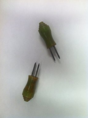 <em>Corn Holders</em>, ca. 1939. Bakelite, metal, 2 x 5/8 x 5/8 in. (5.1 x 1.6 x 1.6 cm). Brooklyn Museum, Gift of Joseph V. Garry, 2013.42a-b. Creative Commons-BY (Photo: Brooklyn Museum, CUR.2013.42a-b.jpg)