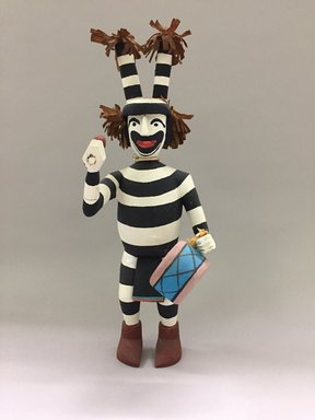 Hopi Pueblo. <em>Kachina Doll, Koshare Clown</em>, late 20th century. Wood (likely cottonwood), plant fibers, fabric, paint, cord, height: 15 × 5 1/4 × 7 in. (38.1 × 13.3 × 17.8 cm). Brooklyn Museum, Gift of Joan and Sanford Krotenberg, 2013.64.11. Creative Commons-BY (Photo: , CUR.2013.64.11_front.jpg)