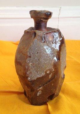 Kakurezaki Ryuichi (Japanese, born 1950). <em>Sake Bottle</em>, 1990. Stoneware with ash glaze; bizen ware, 5 11/16 x 2 3/4 in. (14.5 x 7 cm). Brooklyn Museum, Gift of Shelly and Lester Richter, 2013.83.21. Creative Commons-BY (Photo: Brooklyn Museum, CUR.2013.83.21.jpg)