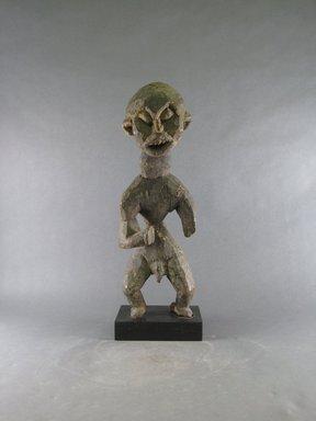 Bamileke. <em>Figure</em>, 20th century. Wood, 17 15/16 x 5 7/8 x 5 1/8 in. (45.5 x 15 x 13 cm). Brooklyn Museum, Gift in memory of Frederic Zeller, 2014.54.11 (Photo: Brooklyn Museum, CUR.2014.54.11_front.jpg)