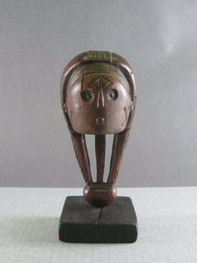 Mbundu. <em>Staff Finial</em>, early 20th century. Wood, organic material, 5 1/2 x 2 3/4 x 2 9/16 in. (14 x 7 x 6.5 cm). Brooklyn Museum, Gift in memory of Frederic Zeller, 2014.54.12 (Photo: Brooklyn Museum, CUR.2014.54.12_front.jpg)