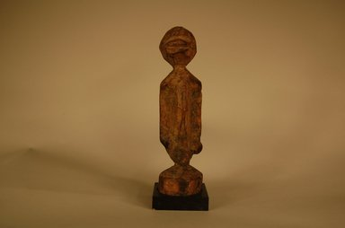 Dogon. <em>Figure</em>, early 20th century. Wood, organic materials, 6 11/16 x 1 15/16 x 1 15/16 in. (17 x 5 x 5 cm). Brooklyn Museum, Gift in memory of Frederic Zeller, 2014.54.16 (Photo: Brooklyn Museum, CUR.2014.54.16_overall.jpg)