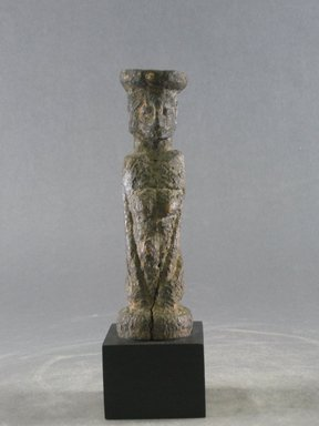 Dogon. <em>Figure of Kneeling Female</em>, early 20th century. Wood, 5 1/2 x 1 11/16 in. (14 x 4.3 cm). Brooklyn Museum, Gift in memory of Frederic Zeller, 2014.54.18 (Photo: Brooklyn Museum, CUR.2014.54.18_front.jpg)