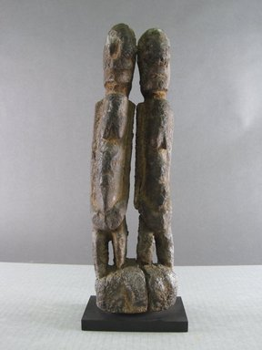Dogon. <em>Figure of Twins</em>, early 20th century. Wood, organic or sacrificial materials, 11 5/8 x 3 9/16 x 2 3/16 in. (29.5 x 9 x 5.5 cm). Brooklyn Museum, Gift in memory of Frederic Zeller, 2014.54.20 (Photo: Brooklyn Museum, CUR.2014.54.20_front.jpg)