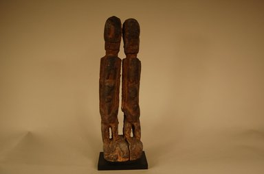 Dogon. <em>Figure of Twins</em>, early 20th century. Wood, organic or sacrificial materials, 11 5/8 x 3 9/16 x 2 3/16 in. (29.5 x 9 x 5.5 cm). Brooklyn Museum, Gift in memory of Frederic Zeller, 2014.54.20 (Photo: Brooklyn Museum, CUR.2014.54.20_view04.jpg)