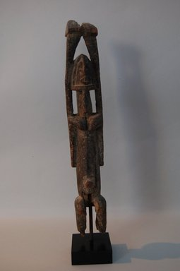 Dogon. <em>Figure with Upright Arms</em>, early 20th century. Wood, 13 3/16 x 2 3/16 x 2 3/8 in. (33.5 x 5.5 x 6 cm). Brooklyn Museum, Gift in memory of Frederic Zeller, 2014.54.22 (Photo: Brooklyn Museum, CUR.2014.54.22_front.jpg)