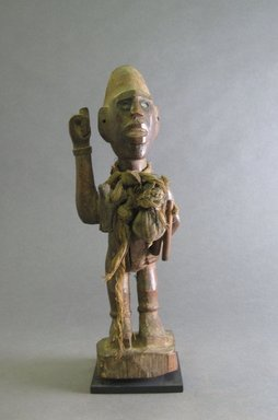 Kongo. <em>Power Figure (Nkisi)</em>, 20th century. Wood, fiber, resin, cloth, glass, 10 1/4 x 3 9/16 x 3 9/16 in. (26 x 9 x 9 cm). Brooklyn Museum, Gift in memory of Frederic Zeller, 2014.54.26 (Photo: Brooklyn Museum, CUR.2014.54.26_front.jpg)
