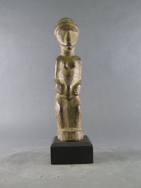 Lobi. <em>Figure of a Female (Bateba)</em>, 1900-1981. Wood, 10 5/8 x 2 3/8 x 2 15/16 in. (27 x 6 x 7.5 cm). Brooklyn Museum, Gift in memory of Frederic Zeller, 2014.54.29 (Photo: Brooklyn Museum, CUR.2014.54.29_front.jpg)