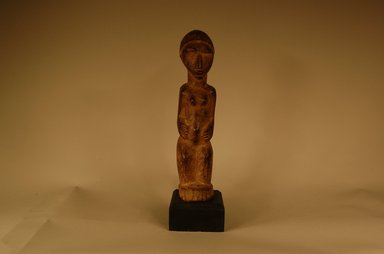 Lobi. <em>Figure of a Female (Bateba)</em>, 1900-1981. Wood, 10 5/8 x 2 3/8 x 2 15/16 in. (27 x 6 x 7.5 cm). Brooklyn Museum, Gift in memory of Frederic Zeller, 2014.54.29 (Photo: Brooklyn Museum, CUR.2014.54.29_overall.jpg)