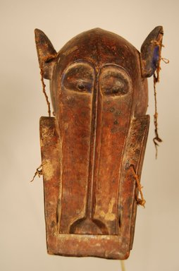Senufo. <em>Mask (Korobla)</em>, 20th century. Wood, pigment, hide, fiber, metal, 6 11/16 x 7 7/8 x 13 3/4 in. (17 x 20 x 35 cm). Brooklyn Museum, Gift in memory of Frederic Zeller, 2014.54.42 (Photo: Brooklyn Museum, CUR.2014.54.42_front.jpg)