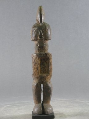 Teke. <em>Figure of Bearded Male</em>, 20th century. Wood, organic materials, 7 7/8 x 1 1/2 x 1 9/16 in. (20 x 3.8 x 4 cm). Brooklyn Museum, Gift in memory of Frederic Zeller, 2014.54.49 (Photo: Brooklyn Museum, CUR.2014.54.49_front.jpg)