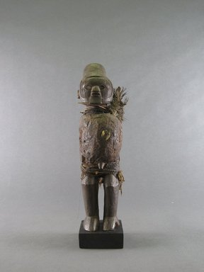Teke. <em>Figure of Male</em>, early 20th century. Wood, feathers, fiber, cowrie shell, hide, glass, resin, 10 1/4 x 3 1/8 x 3 1/4 in. (26 x 8 x 8.3 cm). Brooklyn Museum, Gift in memory of Frederic Zeller, 2014.54.50 (Photo: Brooklyn Museum, CUR.2014.54.50_front.jpg)