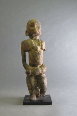 Possibly Igbo. <em>Figure of Maternity</em>, 20th century. Wood, 12 3/16 x 3 15/16 x 4 1/8 in. (31 x 10 x 10.5 cm). Brooklyn Museum, Gift in memory of Frederic Zeller, 2014.54.51 (Photo: Brooklyn Museum, CUR.2014.54.51_front.jpg)