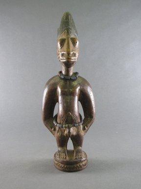 Yorùbá artist. <em>Male twin figure (Ère Ìbejì)</em>, 20th century. Wood, pigment, beads, 11 7/16 x 3 15/16 x 2 3/8 in. (29 x 10 x 6 cm). Brooklyn Museum, Gift in memory of Frederic Zeller, 2014.54.53 (Photo: Brooklyn Museum, CUR.2014.54.53_front.jpg)