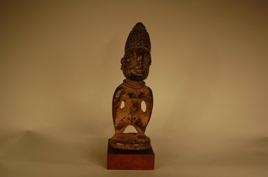 Yorùbá artist. <em>Male twin figure (Ère Ìbejì)</em>, 20th century. Wood, pigment, beads, 11 7/16 x 3 15/16 x 2 3/8 in. (29 x 10 x 6 cm). Brooklyn Museum, Gift in memory of Frederic Zeller, 2014.54.53 (Photo: Brooklyn Museum, CUR.2014.54.53_overall2.jpg)