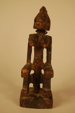 Possibly Dogon. <em>Figure of Seated Female</em>, 20th century. Wood, metal, 5 x 1 11/16 in. (12.8 x 4.3 cm). Brooklyn Museum, Gift in memory of Frederic Zeller, 2014.54.7 (Photo: Brooklyn Museum, CUR.2014.54.7_view01.jpg)