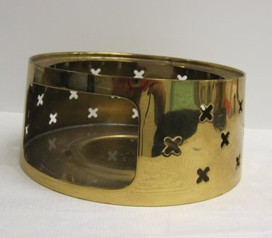 Anton (Tommi) Parzinger (American, born Germany 1903-1981). <em>Coffee Pot Stand, Part of Coffee Set</em>, ca. 1952. Brass, other metals, 2 3/4 x 6 3/8 in. (7 x 16.2 cm). Brooklyn Museum, Gift of Ravi R. Mathura, 2015.103.6 (Photo: Brooklyn Museum, CUR.2015.103.6.jpg)