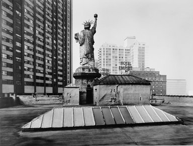 Harry Wilks (American, born 1942). <em>Statue of Liberty of W. 64th Street</em>, 1981. Gelatin silver photograph, sheet: 11 x 14 in. (27.9 x 35.6 cm). Brooklyn Museum, Gift of the artist, 2015.34. © artist or artist's estate (Photo: Image courtesy of Harry Wilks, CUR.2015.34_HarryWilks_photograph.jpg)