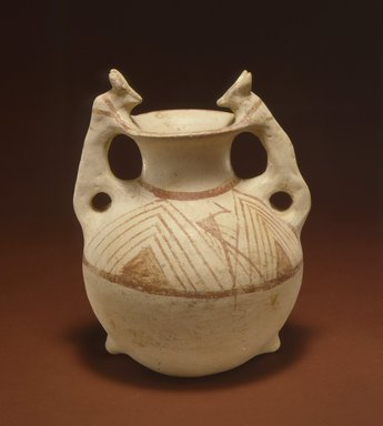 <em>Twin-Spouted Vessel with Theriomorphic Handles</em>, 3rd-2nd century B.C.E. Clay, slip, height: 9 13/16 in. (25 cm). Brooklyn Museum, Gift of the Arthur M. Sackler Foundation, NYC, in memory of James F. Romano, 2015.65.3. Creative Commons-BY (Photo: Photograph courtesy of the Arthur M. Sackler Foundation, New York, CUR.2015.65.3_Sackler_Foundation_image.jpg)