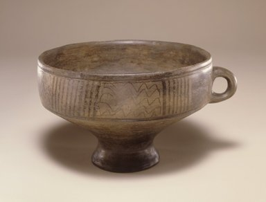 <em>Footed Bowl</em>, late 2nd-1st millennium B.C.E. Clay, slip, height: 4 5/16 in. (11 cm). Brooklyn Museum, Gift of the Arthur M. Sackler Foundation, NYC, in memory of James F. Romano, 2015.65.5. Creative Commons-BY (Photo: Photograph courtesy of the Arthur M. Sackler Foundation, New York, CUR.2015.65.5_Sackler_Foundation_image.jpg)