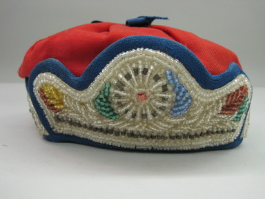 Iroquois. <em>Crown Style Cap</em>, ca. 1880-1890. Cloth, beads, 3 1/2 × 8 3/4 × 7 in. (8.9 × 22.2 × 17.8 cm). Brooklyn Museum, Gift of the Edward J. Guarino Collection in memory of Josephine M. Guarino, 2016.11.15. Creative Commons-BY (Photo: , CUR.2016.11.15_front.jpg)