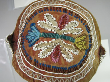 Iroquois. <em>English Style Cap</em>, ca. 1880-1890. Velvet, cloth, beads, ribbon, Including front flap: 6 1/4 × 6 1/2 × 9 × 9 1/4 in. (15.9 × 16.5 × 22.9 × 23.5 cm). Brooklyn Museum, Gift of the Edward J. Guarino Collection in honor of David Feils, 2016.11.17. Creative Commons-BY (Photo: , CUR.2016.11.17_top.jpg)