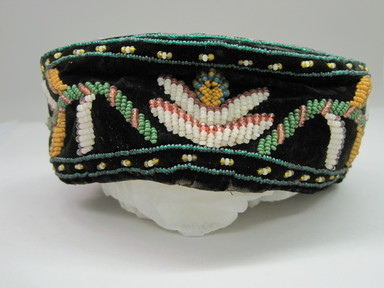 Iroquois. <em>Smoking Cap</em>, ca. 1975. Velvet, cloth, beads, 2 15/16 × 7 1/4 × 7 1/4 in. (7.5 × 18.4 × 18.4 cm). Brooklyn Museum, Gift of the Edward J. Guarino Collection in memory of Josephine M. Guarino, 2016.11.19. Creative Commons-BY (Photo: , CUR.2016.11.19_view01.jpg)