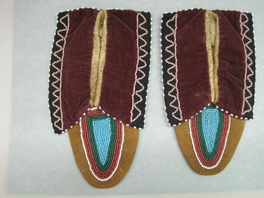 Delaware. <em>Youth Moccasins</em>, ca. 1900. Hide, cloth, beads, 4 1/4 × 1/8 × 7 3/8 in. (10.8 × 0.3 × 18.7 cm). Brooklyn Museum, Gift of the Edward J. Guarino Collection in memory of Edgar J. Guarino, 2016.11.3a-b. Creative Commons-BY (Photo: , CUR.2016.11.3a-b.jpg)
