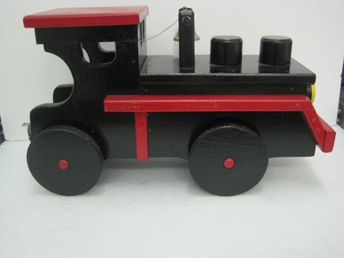 Frank Tilton (American). <em>Engine, from Circus Train</em>, copyright 1953. Wood, pigment, metal, 10 1/2 x 7 5/8 x 22 1/8 in. (26.7 x 19.4 x 56.2 cm). Brooklyn Museum, Purchased with funds given in honor of Henry Christensen III, 2016.6.1. Creative Commons-BY (Photo: Brooklyn Museum, CUR.2016.6.1_side.jpg)