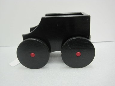 Frank Tilton (American). <em>Coal Car, from Circus Train</em>, copyright 1953. Wood, pigment, metal, 8 1/2 x 8 1/2 x 12 3/4 in. (21.6 x 21.6 x 32.4 cm). Brooklyn Museum, Purchased with funds given in honor of Henry Christensen III, 2016.6.2. Creative Commons-BY (Photo: Brooklyn Museum, CUR.2016.6.2_side.jpg)