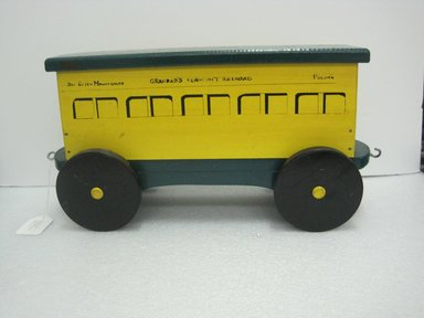 Frank Tilton (American). <em>Passenger Car, from Circus Train</em>, copyright 1953. Wood, pigment, metal, 10 1/2 x 7 1/2 x 22 in. (26.7 x 19.1 x 55.9 cm). Brooklyn Museum, Purchased with funds given in honor of Henry Christensen III, 2016.6.3. Creative Commons-BY (Photo: Brooklyn Museum, CUR.2016.6.3_side.jpg)