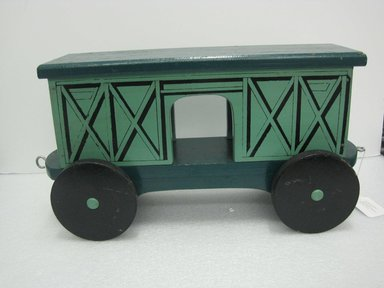 Frank Tilton (American). <em>Freight Car, from Circus Train</em>, copyright 1953. Wood, pigment, metal, 10 1/2 x 7 5/8 x 22 1/8 in. (26.7 x 19.4 x 56.2 cm). Brooklyn Museum, Purchased with funds given in honor of Henry Christensen III, 2016.6.5. Creative Commons-BY (Photo: Brooklyn Museum, CUR.2016.6.5_side.jpg)