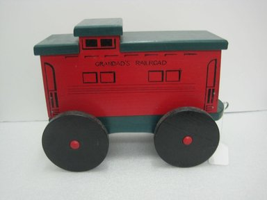 Frank Tilton (American). <em>Caboose, from Circus Train</em>, copyright 1953. Wood, pigment, metal, 11 3/4 x 7 7/8 x 16 in. (29.8 x 20 x 40.6 cm). Brooklyn Museum, Purchased with funds given in honor of Henry Christensen III, 2016.6.6. Creative Commons-BY (Photo: Brooklyn Museum, CUR.2016.6.6_side.jpg)
