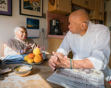Kris Graves (American, born 1982). <em>Tarabu and Mamie Kirkland in the Kitchen, Los Angeles, California</em>, 2017. Inkjet print, sheet: 17 x 22 in. . Brooklyn Museum, Gift of the artist, 2017.25.4. © artist or artist's estate (Photo: Image courtesy of Kris Graves, CUR.2017.25.4_KrisGraves_photograph.jpg)