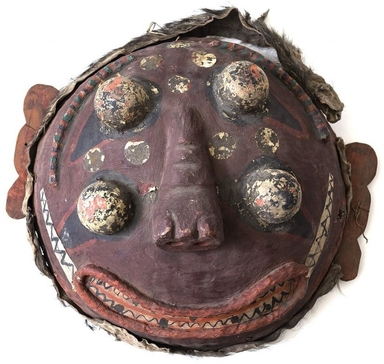 <em>Ritual Mask</em>, probably late 19th century. Papier mache, cloth, and pigment on basketry, bear skin and wood, diameter: 25 9/16 in. (65.0 cm). Brooklyn Museum, Gift of the Carroll Family Collection, 2019.45.2 (Photo: , CUR.2019.45.2.jpeg)