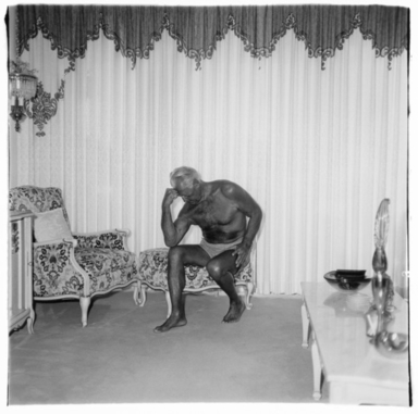 Diane Arbus (American, 1923-1971). <em>Charles Atlas Seated in His Palm Beach Home, Fla.</em>, 1969. Gelatin silver photograph, sheet: 20 × 16 in. (50.8 × 40.6 cm). Brooklyn Museum, Gift of Jeffrey Fraenkel and Frish Brandt, 2019.49.3 (Photo: Image courtesy of Fraenkel Gallery, CUR.2019.49.3_FraenkelGallery_photograph.jpg)