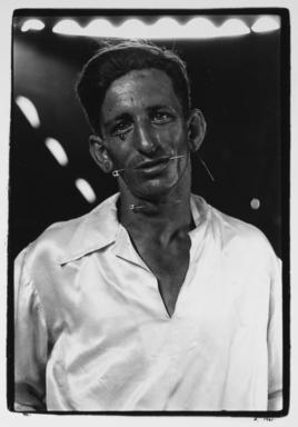 Diane Arbus (American, 1923-1971). <em>The Human Pincushion, Louis Ciervo, in His Silk Shirt, Hagerstown, Md.</em>, 1961. Gelatin silver photograph, sheet: 14 × 11 in. (35.6 × 27.9 cm). Brooklyn Museum, Gift of Jeffrey Fraenkel and Frish Brandt, 2019.49.4 (Photo: Image courtesy of Fraenkel Gallery, CUR.2019.49.4_FraenkelGallery_photograph.jpg)