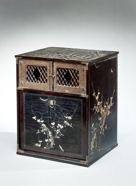 <em>Shrine Cabinet</em>, 17th-18th century. Lacquered wood inlaid with mother-of-pearl; metal hardware, 18 × 14 15/16 × 12 3/4 in. (45.7 × 37.9 × 32.4 cm). Brooklyn Museum, Gift of Nicholas Grindley, 2019.8.1 (Photo: , CUR.2019.8.1_threequarter_right.jpg)