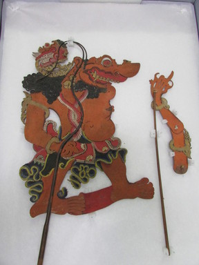<em>Shadow Play Figure (Wayang kulit)</em>. Leather, pigment, wood, fiber, wire, 21 1/16 × 12 5/8 in. (53.5 × 32 cm). Brooklyn Museum, 2045. Creative Commons-BY (Photo: , CUR.2045_overall.jpg)