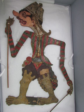 <em>Shadow Play Figure (Wayang kulit)</em>. Leather, pigment, wood, fiber, 26 3/4 × 14 15/16 in. (68 × 38 cm). Brooklyn Museum, 2053. Creative Commons-BY (Photo: , CUR.2053_overall.jpg)
