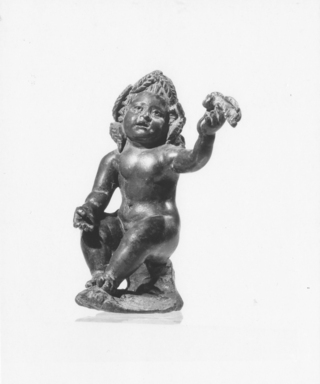 Roman. <em>Statuette of a Seated Eros, Nude, Cast Solid</em>. Bronze Brooklyn Museum, Bequest of William H. Herriman, 21.479.6. Creative Commons-BY (Photo: Brooklyn Museum, CUR.21.479.6_NegA_print_bw.jpg)