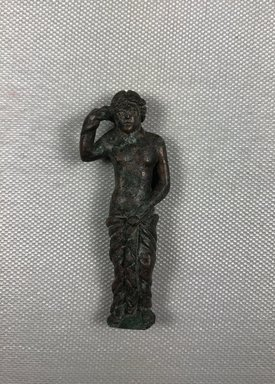 Roman. <em>Statuette of Aphrodite Standing</em>. Bronze, 2 13/16 × 1 × 1/2 in. (7.1 × 2.5 × 1.3 cm). Brooklyn Museum, Bequest of William H. Herriman, 21.479.9. Creative Commons-BY (Photo: , CUR.21.479.9_view01.jpg)