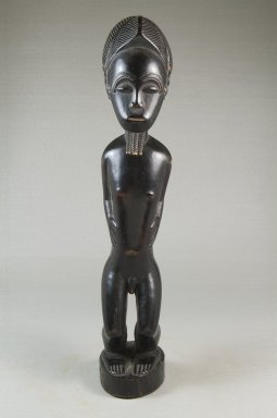 Baule. <em>Male Figure (Blolo bian)</em>, early 20th century. Wood, pigment, 14 15/16 x 3 3/8 x 3 in. (38 x 8.5 x 7.6 cm). Brooklyn Museum, Museum Expedition 1922, Robert B. Woodward Memorial Fund, 22.1091. Creative Commons-BY (Photo: Brooklyn Museum, CUR.22.1091_front_PS5.jpg)