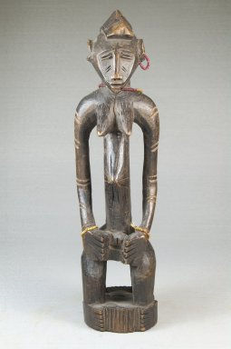 Senufo. <em>Figure of a Seated Woman</em>, late 19th or early 20th century. Wood, glass beads, 12 x 3 x 2 3/4 in. (30.5 x 7.6 x 7 cm). Brooklyn Museum, Museum Expedition 1922, Robert B. Woodward Memorial Fund, 22.1092. Creative Commons-BY (Photo: Brooklyn Museum, CUR.22.1092_front_PS5.jpg)