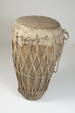 <em>Small Drum</em>, late 19th or early 20th century. Wood, hide, 11 x 5 1/2 in. (28.0 x 14.0 cm). Brooklyn Museum, Museum Expedition 1922, Robert B. Woodward Memorial Fund, 22.1110. Creative Commons-BY (Photo: Brooklyn Museum, CUR.22.1110_front_PS5.jpg)
