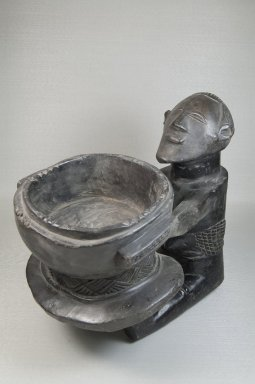 Luba. <em>Bowl with Female Figure</em>, late 19th or early 20th century. Wood, 13 x 10 3/4 x 14 in. (33 x 27.3 x 35.6 cm). Brooklyn Museum, Museum Expedition 1922, Robert B. Woodward Memorial Fund, 22.1135. Creative Commons-BY (Photo: Brooklyn Museum, CUR.22.1135_threequarter_PS5.jpg)